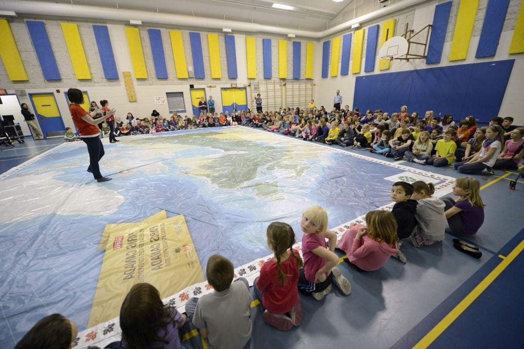 Children in gym with giant map
