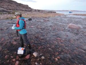 Scientist standing in river